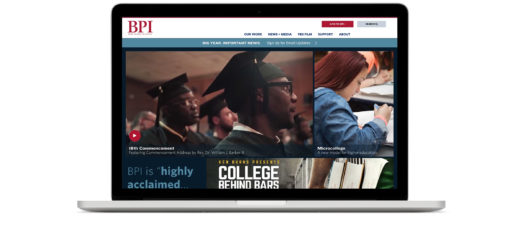 """Laptop displaying BPI homepage that features an image of a commencement ceremony, a student writing at a desk, and art for the """"College Behind Bars"""" film."""