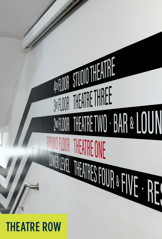Theatre Row: Stripes on a wall with direction signage.